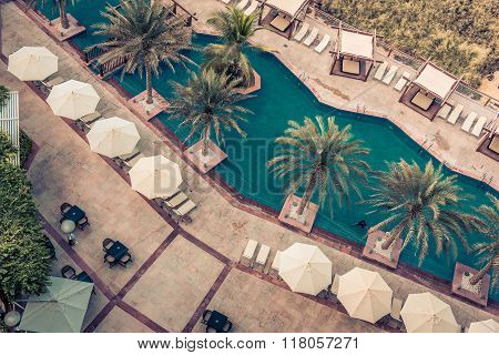 Hotel Poolside with Parasols and Palms. Top view shot