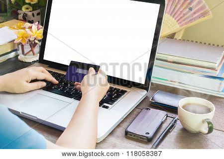 People Hands Hold Credit Or Debit Card Infront Of Notebook For Internet Working