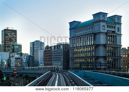 Tokyo Monorail At Dusk With Buildings And Train  At Blue Hour