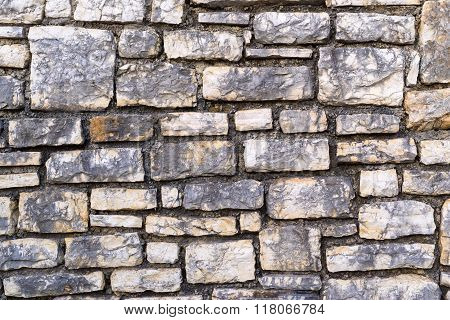 Channelled Textured Surface Of A Stone Wall