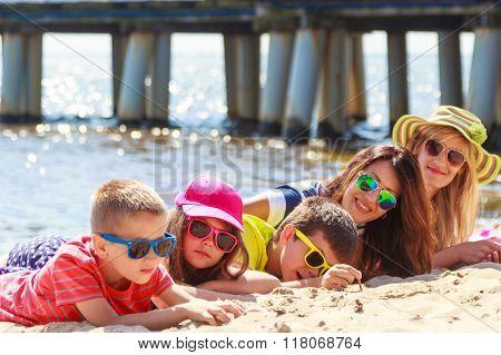 Happy Family Women Kids Sunbathing On Beach.