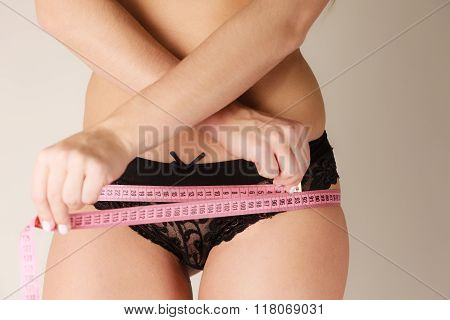 Woman Measuring Her Hips Closeup