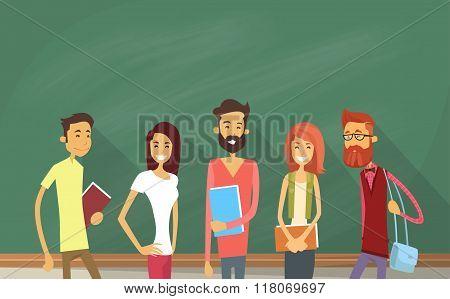 Student Group Over Green Blackboard Holding Books