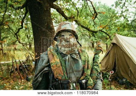 Hidden unidentified re-enactor dressed as World War II german we