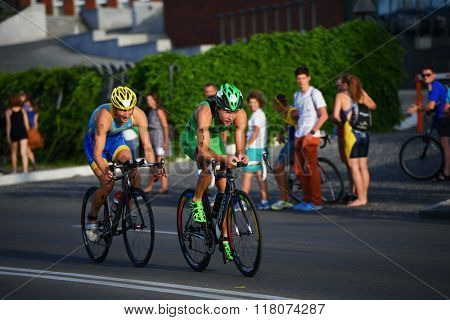 DNEPROPETROVSK, UKRAINE - MAY 24, 2014: Yegor Martynenko (right) and Sergiy Kokhan, both of Ukraine, leading in the second stage of ETU Sprint Triathlon European cup