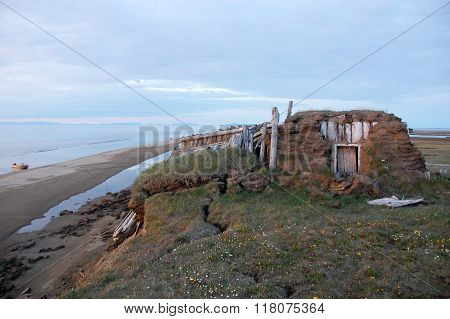 Abandoned Broken Mud Hut At Arctic Island Summer Calm Sea Coast