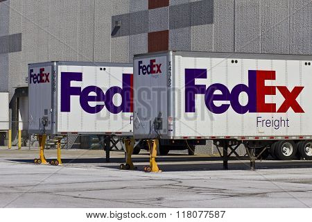 Indianapolis - Circa February 2016: Federal Express Trucks In Loading Docks VI