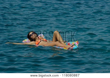 Woman On Air Mattress In The Sea
