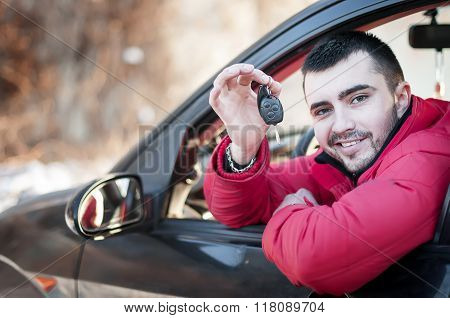 Handsome Man In His  Car With Car Key.