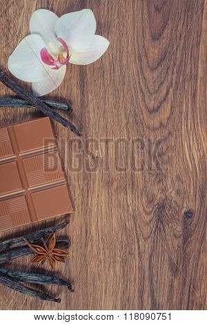 Vintage Photo, Milk Chocolate, Fragrant Vanilla Sticks And Blooming Orchid, Copy Space For Text