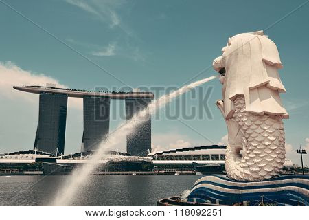 SINGAPORE - APR 5: Singapore city urban view with Merlion statue on April 5, 2013 in Singapore. It is 4th largest financial center and 1 of 5 world busiest ports.