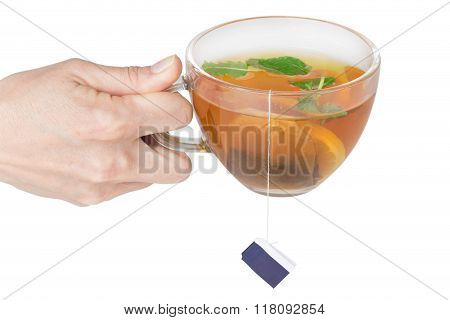 Female Hand Holding A Cup Of Tea
