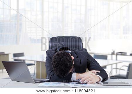 Depressed Employee Sleeping On The Table