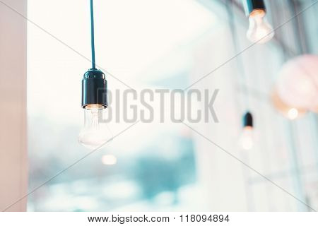 Lighting decor. Beautiful lamp by the window amid the bright rooms