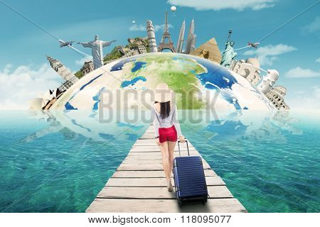 Female Tourist Travelling To The Worldwide Monument