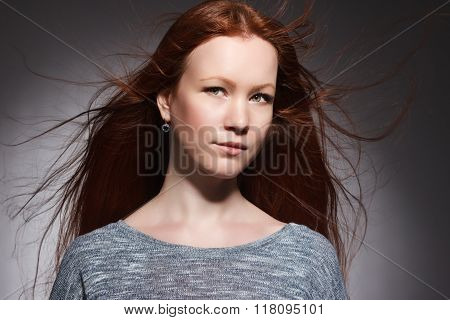 young woman with red long hair .