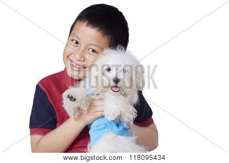 Joyful Boy Embrace His Dog In Studio