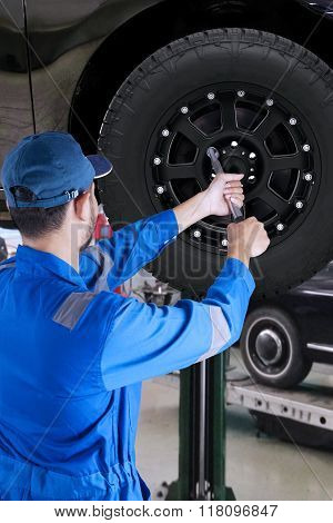 Mechanic Replace New Tire In Workshop