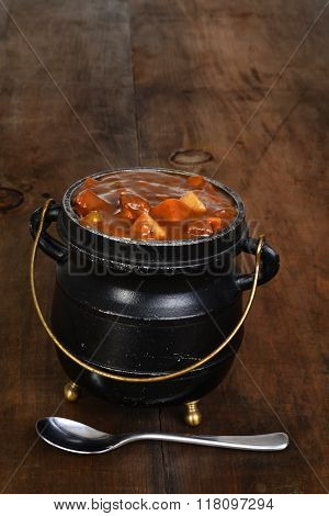 chunky beef stew with a spoon