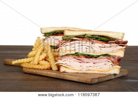 turkey club sandwich with french fries