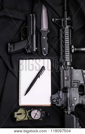 .notebook,pen,gun,knife,rifle And Compass.top View.