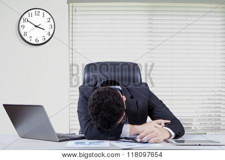 Overworked Male Worker Sleeping In Office
