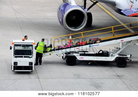 Loading luggage onto an aeroplane.