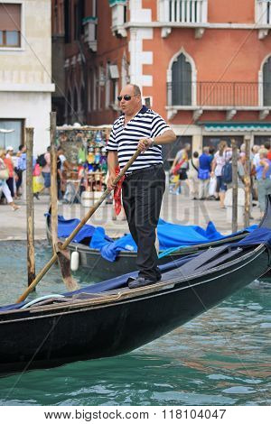Venice, Italy - September 04, 2012: Gondolier Rides Gondola On Grand Canal In Venice