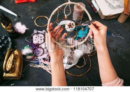craftswoman shows  Dreamcatcher.