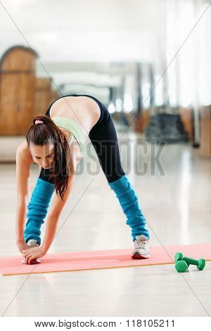 athlete doing stretching after a workout