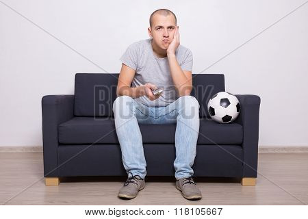 Bored Soccer Fan Watching Game On Tv