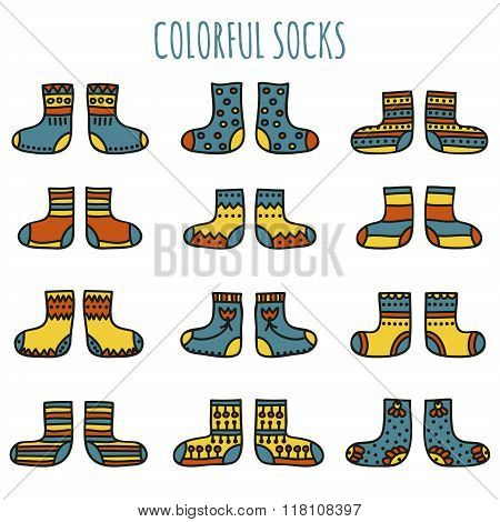 Set of colorful socks with different patterns in desaturated colors on a white background
