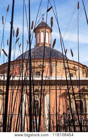 VALENCIA, SPAIN -  NOV 5 2015 : The Our Lady of Helpless church is viewed through an artwork.