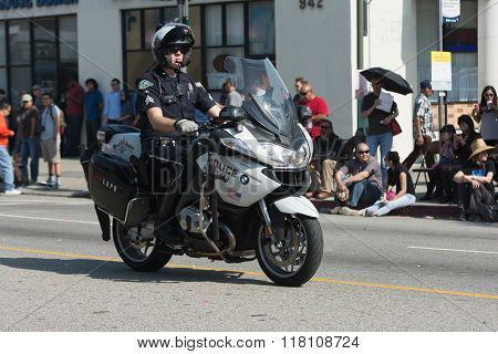 Motorcycle Police Officer During The 117Th Golden Dragon Parade,