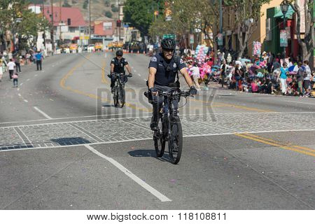 Bicycle Police Officer During The 117Th Golden Dragon Parade,