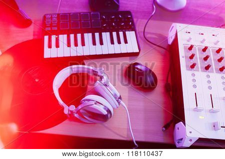 Dj mixer with headphones and synthesizer