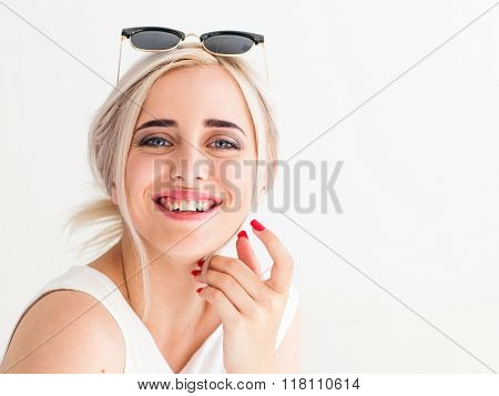 young blonde in sunglasses laughing frankly