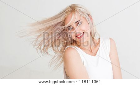 Woman with flying dyed hair