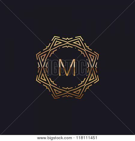 art-deco golden M frame