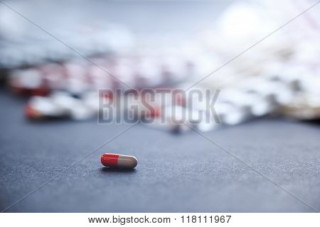 Single orange-white capsule