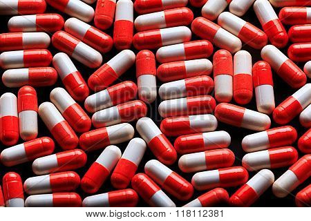 Many medicine red and white capsules