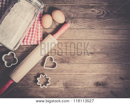 Flour, rolling pin, eggs and moulds