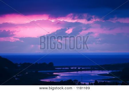 Twilight Blue, Mauve And Pink Sunset Overlooking Lagoon And Beac