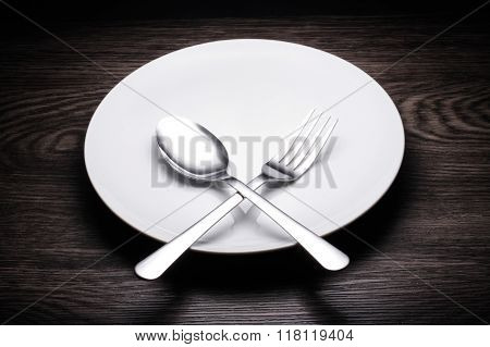 A Set Of Cutlery On Wooden Background