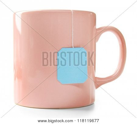 Pink cup of tea isolated on white background. Teabag with blue label