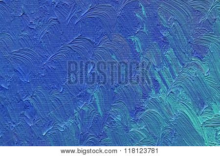 Colored brushstrokes of blue oil paint on canvas