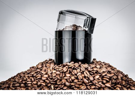 Coffee mill and pile of coffee beans - Isolated