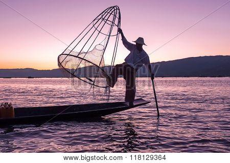 Silhouette of fisherman at sunset Inle Lake Burma Myanmar