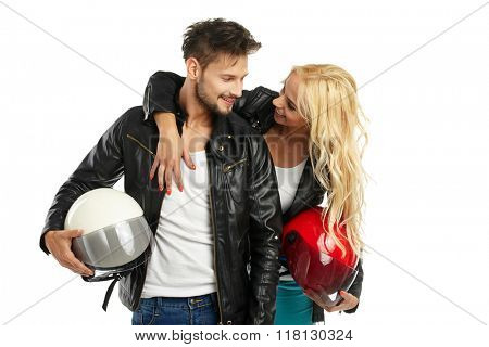 motorcyclists couple with helmets in hand. Studio shoot