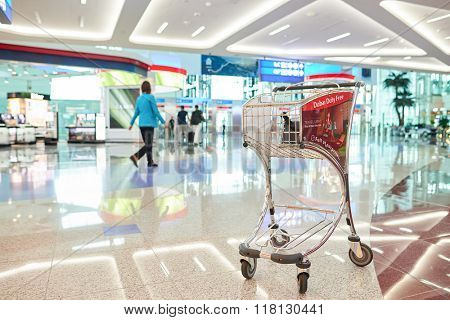 DUBAI, UAE - JUNE 04, 2014: baggage trolley at retail area in the concourse A. Dubai Duty Free is the company responsible for the duty-free operations at Dubai International Airport